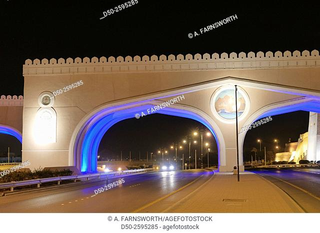 MUSCAT, OMAN Illuminated entrance gateway by road to the Muttrah and Sultan Qaboos port. Urban beautification