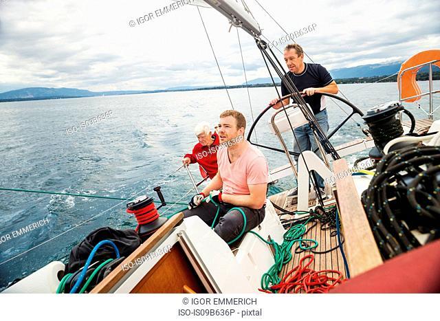 Three generation family on sailing boat, Geneva, Switzerland, Europe
