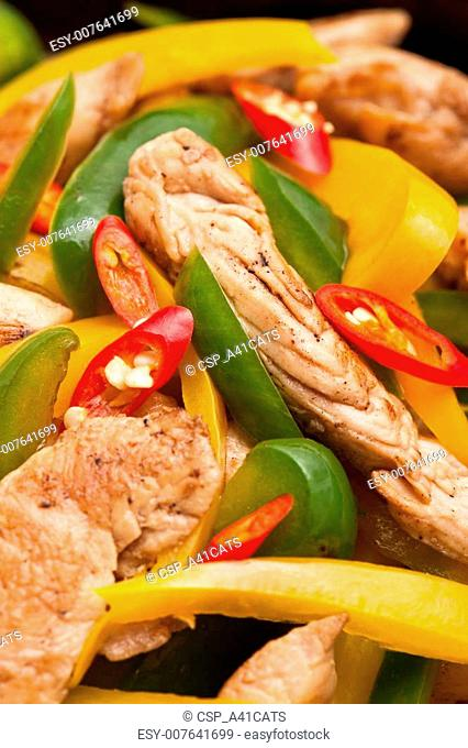 Fried Chicken with capsicum on red table cloth