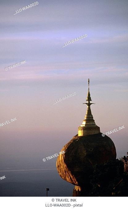 View of Kyaik-Tiyo Pagoda The Golden Rock at Sunset  Kyaikto, Myanmar, Asia