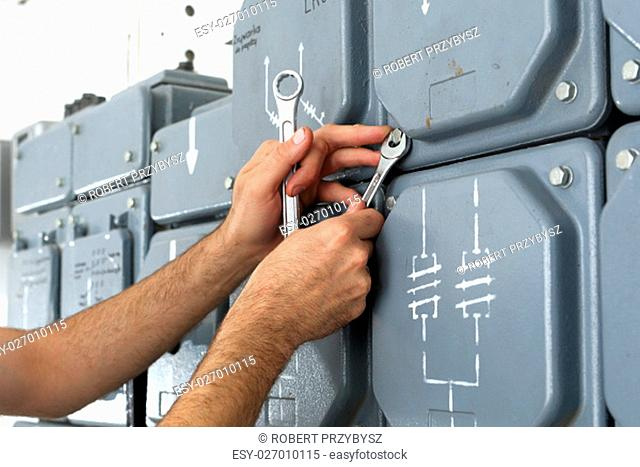 plugs,electrical switches plugs on the dashboard. electrician repairs dashboard. electrical repair,switching current