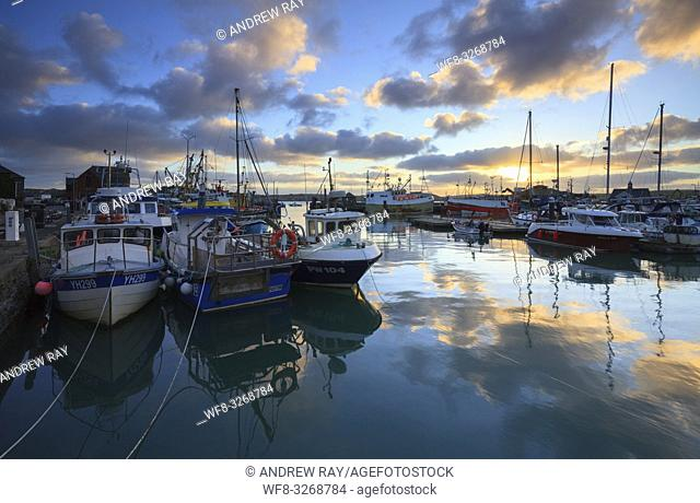 Boats in Padstow Harbour on the North Coast of Cornwall, capture shortly after sunrise on a still morning in January