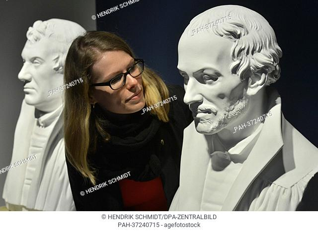 A woman looks at a bust of reformer Philipp Melanchthon at the Melanchthon House in Wittenberg, Germany, 15 February 2013