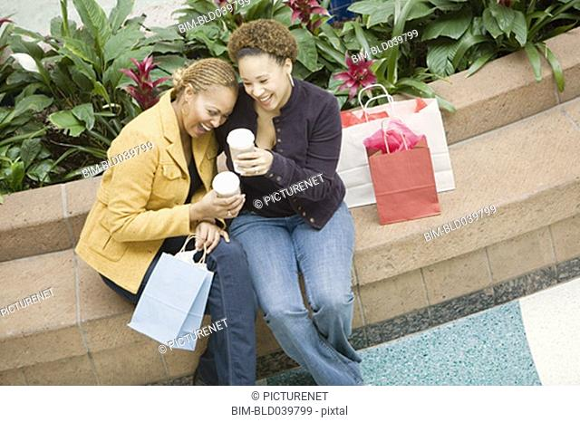 Mixed Race women with shopping bags