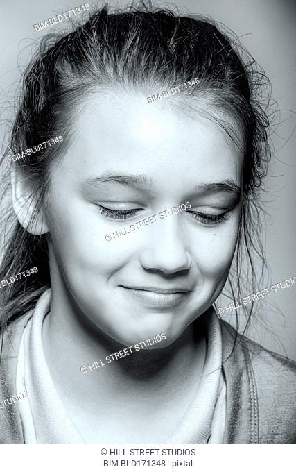 Close up of pouting girl looking down