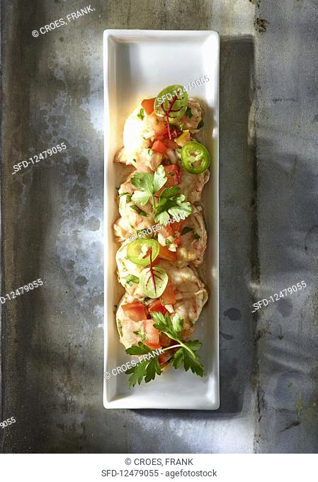 Ceviche with tomatoes and herbs