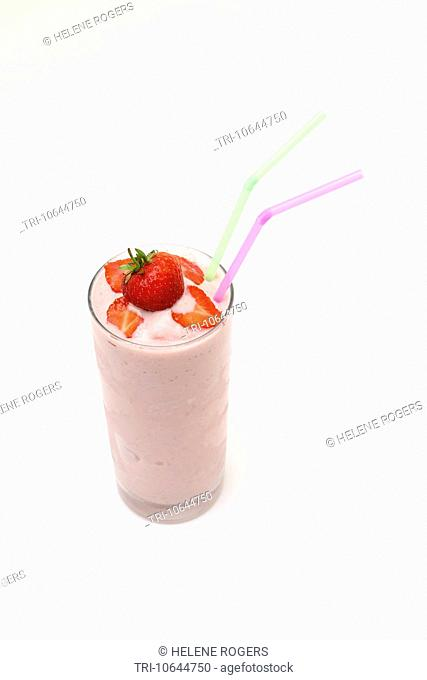 Strawberry Milkshake In A Glass With Strawberries And Two Straws