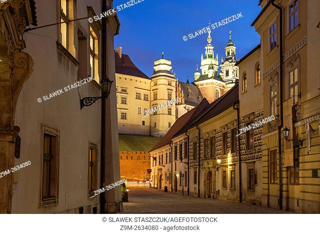 Evening on Kanonicza street in Krakow old town, Poland. Wawel Castle in the distance. UNESCO world heritage site