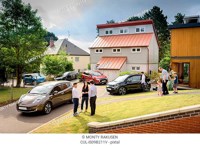 People in neighbourhood with electric cars