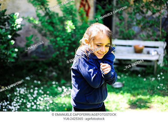 Little girl smiling in garden