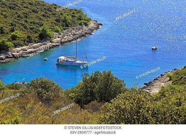Yachts moored in a rocky bay near Palmizana, St Clement, Pakleni Islands near Hvar, Croatia, Dalmatia, Dalmatian Coast, Europe