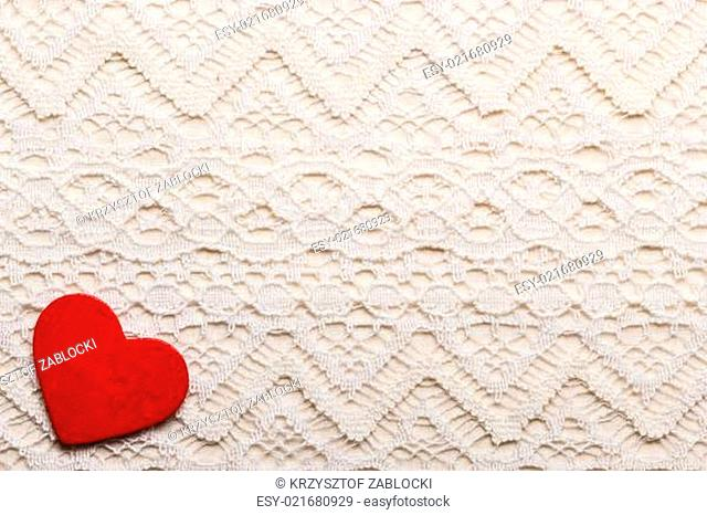 Red heart love symbol on lace background