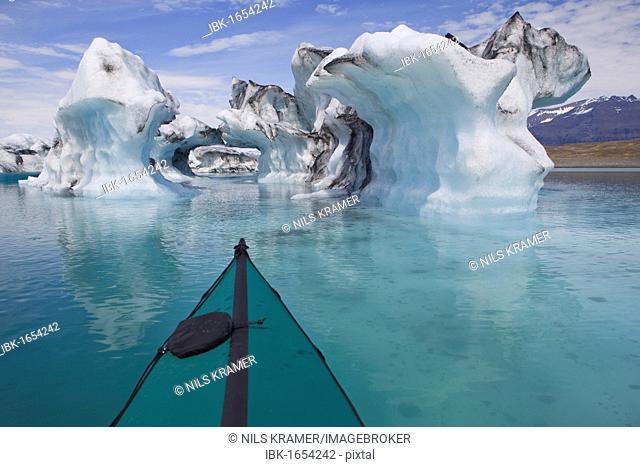 Folding kayak on the Joekulsarlon glacial lake, Iceland, Europe