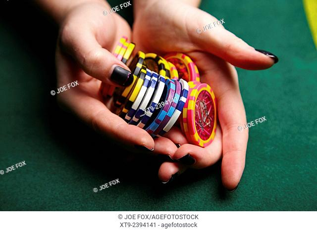 woman holding stack of casino chips