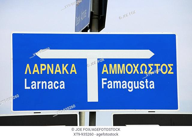 english greek bilingual roadsign on main road between larnaca and famagusta in the republic of cyprus