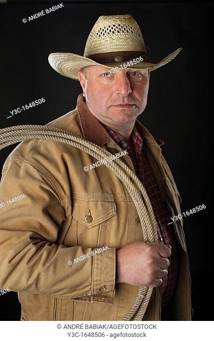 Old cowboy with rope portrait