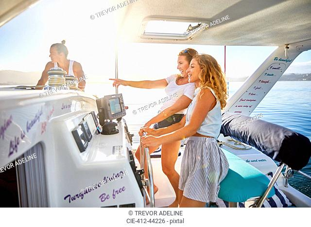 Women at helm of boat