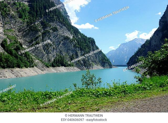 the gigerwald reservoir surrounded by high mountains in the calseisental near bad ragaz