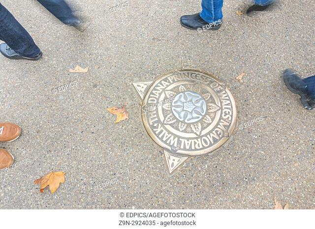 metal plaque indicating directions at the diana princess of wales memorial walk, London, England