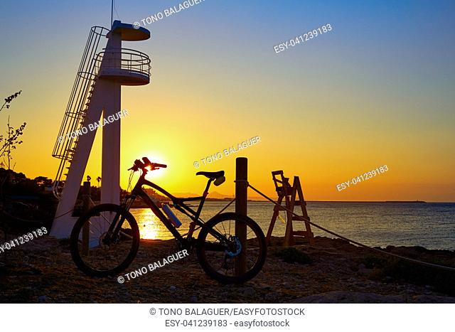 Denia beach las Rotas with bicycle bike in . Alicante of Spain