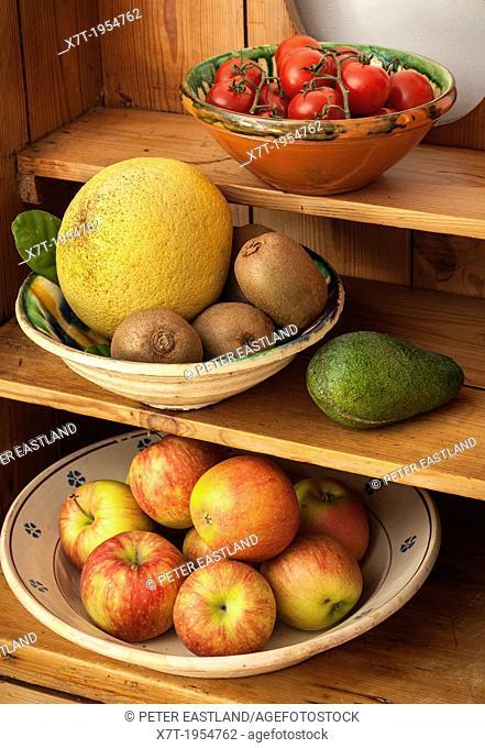 Assorted fruit and vegetables on a kitchen dresser