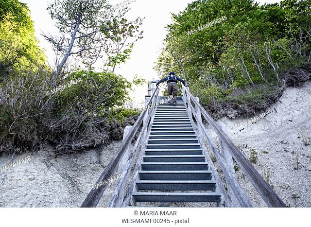 Germany, Mecklenburg-Western Pomerania, Ruegen, Jasmund National Park, HIker ascending stairs