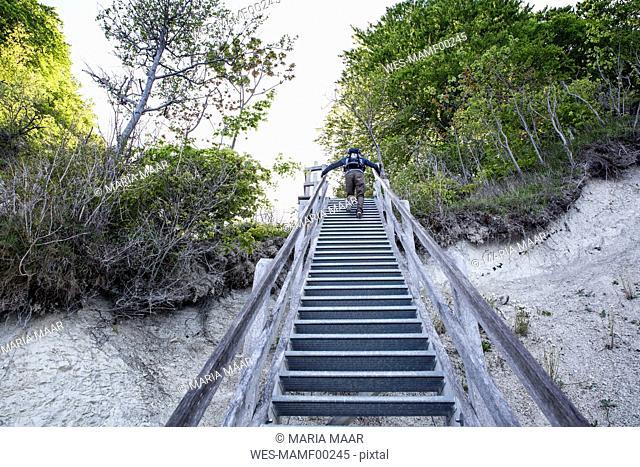 Germany, Mecklenburg-Western Pomerania, Ruegen, Jasmund National Park, HIker ascending stairs