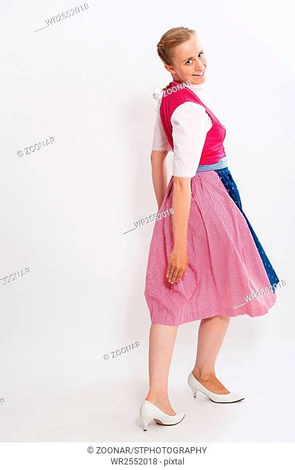 Laughing young bavarian girl in dirndl