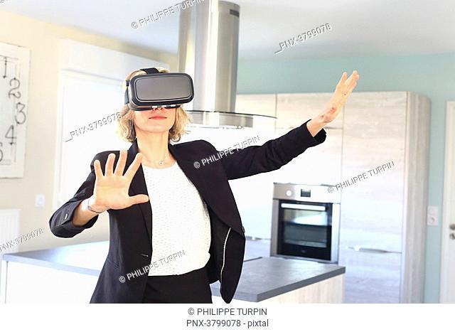 Young woman at home using virtual mask