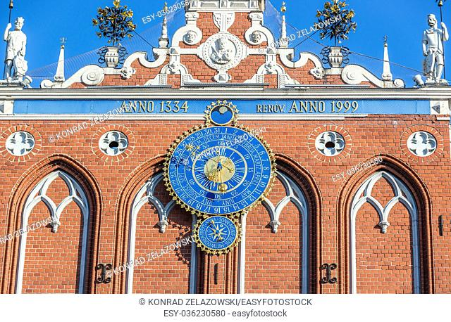 Details of front facade with clock calendar of House of Blackheads building on the Old Town of Riga, capital city of Republic of Latvia