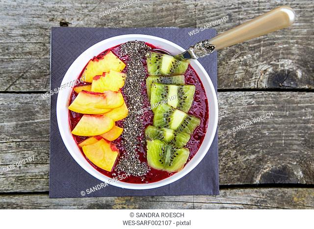 Smoothie with fruits and chia seeds in bowl