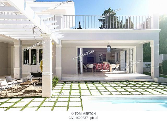 Paving stones at poolside patio of luxury house