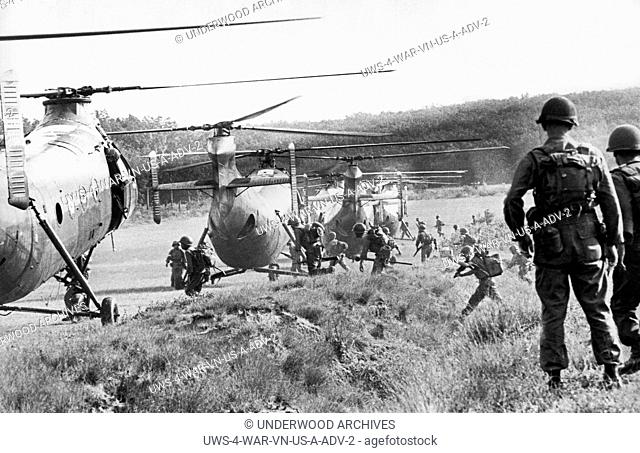 Vietnam: October 25, 1962 American advisors watch as Vietnamese troops run to board helicopters for an airborne anti Viet Cong operation in the jungles near...