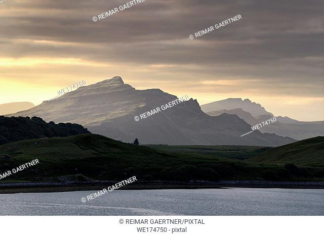 Ben Tianavaig peak at sunset from Sconser on Loch Sligachan with Ben Chracaig and The Storr peaks in distance Isle of Skye Scotland UK