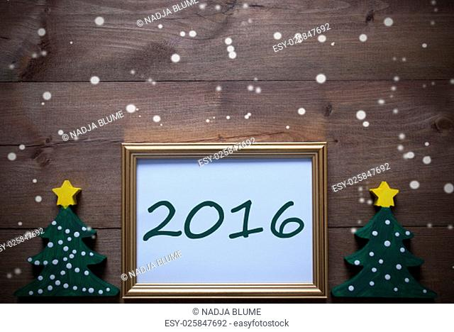 One Golden Picture Frame With Two Green Christmas Tree. Text 2016 For Happy New Year. Christmas Card For Seasons Greetings