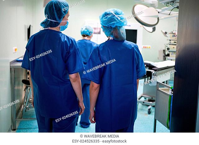 Surgeons walking in operation room