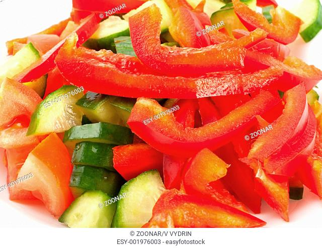 Fresh vegetables and other foodstuffs on white background