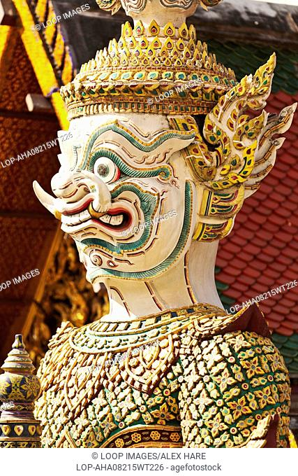 Close up details of the golden figurines around the Royal Palace in Bangkok