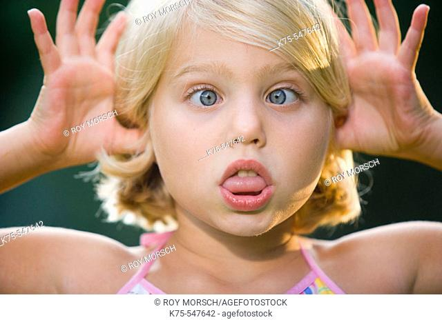 8 year old Caucasian blonde girl playful