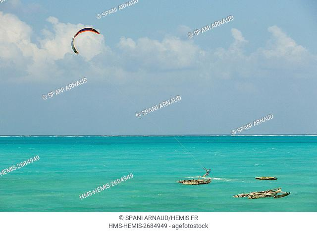 Tanzania, Zanzibar, Jambiani, practicing sports kite surf in the turquoise waters of a tropical lagoon