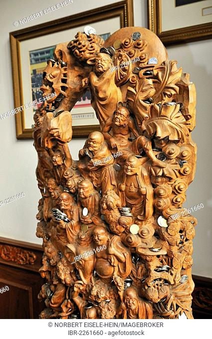 Carved Buddha sculptures with donated money, Jade Buddha Temple, Shanghai, China, Asia