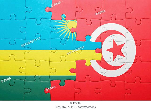 puzzle with the national flag of tunisia and rwanda . concept