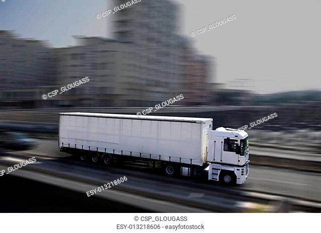 white semi-truck in town