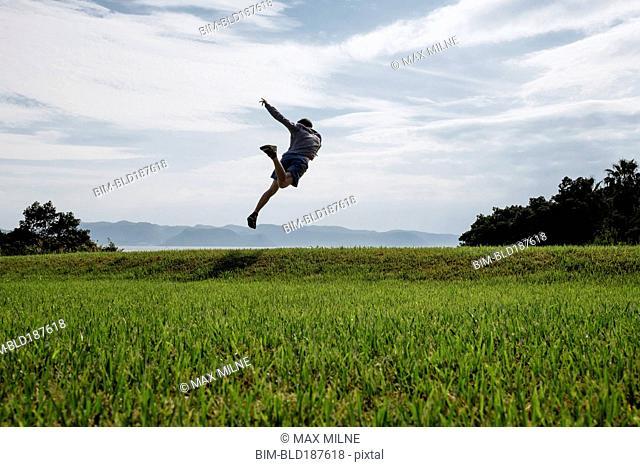 Caucasian man dancing in field