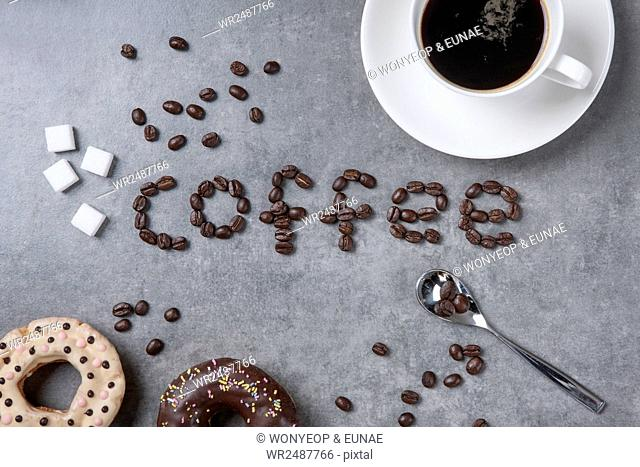 Typographical word of Coffee made of coffee beans with doughnuts and a cup of coffee