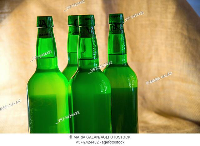 Four bottles of cider. Close view