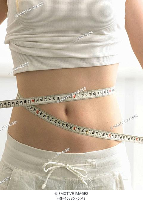 Belly wrapped by a measuring-tape