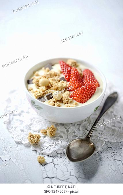 Vegan banana Yesoghurt with strawberries and macadamia nut muesli