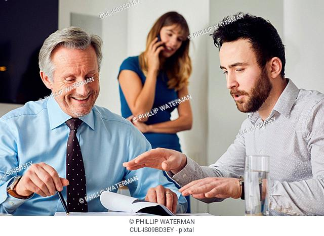 Colleagues in office in meeting