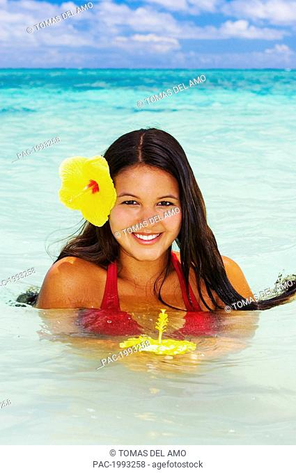 Hawaii, Beautiful Hawaiian Girl With Hibiscus In Ocean, Head And Shoulders Above Water
